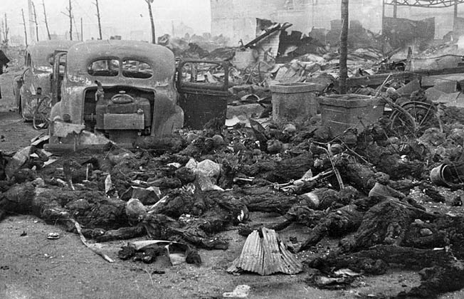 Piles of charred corpses fill a Tokyo street after the March 9-10 raid. The number of dead is estimated to have been as high as 200,000, but the actual figure may never be known.