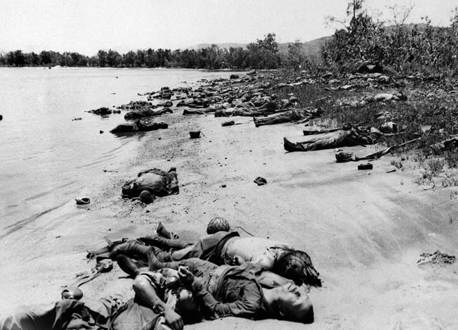 Hundreds of dead Japanese cover a beach after their failed, all-out banzai charge against the 27th Infantry Division, July 7, 1944—the largest banzai charge of the war.