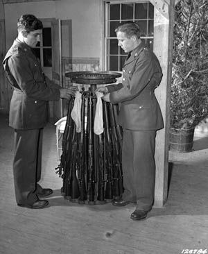 Tis the season to decorate firearms. Privates Kotula and Queen of the U.S. Army hang Christmas stockings on Springfield M1903 rifles at Camp Lee, Virginia, in December 1941.