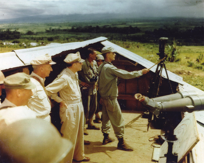 In order to better assess fighting conditions being endured by U.S. and British forces, General Douglas MacArthur and Lt. Gen. Robert Eichelberger take part in an island inspection.